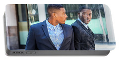 Man Looking At Mirror Portable Battery Charger