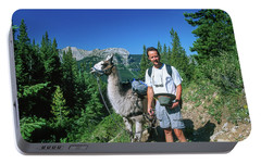 Man Posing With A Llama On A High Mountain Trail Portable Battery Charger by Jerry Voss