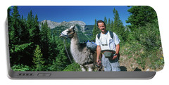 Man Posing With A Llama On A High Mountain Trail Portable Battery Charger