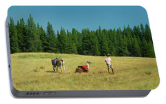 Man Posing With Llamas In A Beautiful Grassy Meadow Portable Battery Charger by Jerry Voss