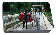 Man Posing With Two Llamas On Wilderness Drawbridge Portable Battery Charger by Jerry Voss