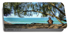 Man Relaxing At The Beach Portable Battery Charger