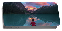 Portable Battery Charger featuring the photograph Man Sit On Rock Watching Lake Louise Morning Clouds With Reflect by William Lee