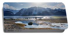 Man Walking On Southeast Alaskan Beach Portable Battery Charger