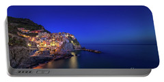 Portable Battery Charger featuring the photograph Manarola Village During Blue Hour At Night by IPics Photography