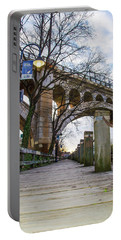Manayunk - Towpath And Bridge Portable Battery Charger by Bill Cannon