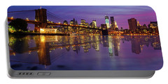 Portable Battery Charger featuring the photograph Manhattan Reflection by Mircea Costina Photography