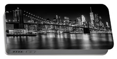 Portable Battery Charger featuring the photograph Manhattan Skyline And Brooklyn Bridge Nightly Impressions  by Melanie Viola