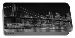 Portable Battery Charger featuring the photograph Manhattan Skyline And Brooklyn Bridge Nightly Impressions - Panoramic by Melanie Viola