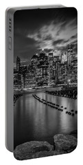 Portable Battery Charger featuring the photograph Manhattan Skyline Evening Atmosphere In New York City - Monochrome Panorama  by Melanie Viola