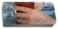 Mans Hand Holding Bloody Mary  Portable Battery Charger by Beth Wolff