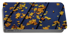 Maple Leaves On A Metal Roof Portable Battery Charger