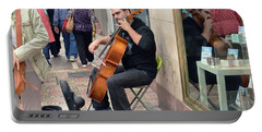Portable Battery Charger featuring the photograph Marbella Cellist  by Harvey Barrison