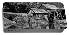Portable Battery Charger featuring the photograph Marby Mill In Black And White by Paul Ward