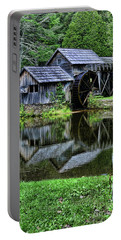 Portable Battery Charger featuring the photograph Marby Mill Reflection by Paul Ward