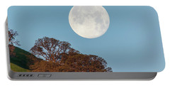 Portable Battery Charger featuring the photograph March Moonset by Marc Crumpler