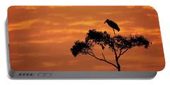 Maribou Stork On Tree With Orange Sunrise Sky Portable Battery Charger