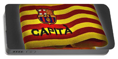Portable Battery Charger featuring the photograph Mas Que Un Capitan - Carles Puyol by Juergen Weiss