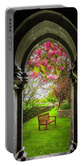 Portable Battery Charger featuring the photograph Medieval Abbey In Irish Spring by James Truett