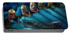 Portable Battery Charger featuring the painting Mekong Weavers by Mojo Mendiola
