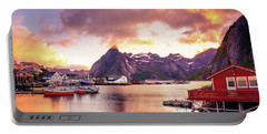 Portable Battery Charger featuring the photograph Midnight Sun On Hamnoy by Dmytro Korol