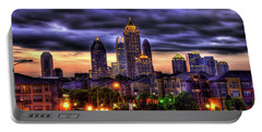 Portable Battery Charger featuring the photograph Midtown Atlanta Towers Over Atlantic Commons by Reid Callaway