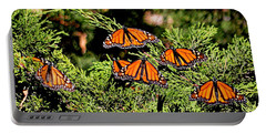 Portable Battery Charger featuring the photograph Migrating Monarchs by AJ Schibig