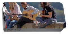 Portable Battery Charger featuring the photograph Mirador Performers - Take 0ne by Harvey Barrison