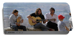 Portable Battery Charger featuring the photograph Mirador Performers - Take Three by Harvey Barrison