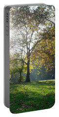 Portable Battery Charger featuring the photograph Misty Fall Day At Hyde Park by Haleh Mahbod