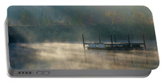 Portable Battery Charger featuring the photograph Misty Sunrise by George Randy Bass