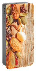 Mixed Nuts On Wooden Background Portable Battery Charger