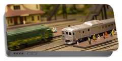 Portable Battery Charger featuring the photograph Model Trains by Patrice Zinck