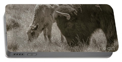 Portable Battery Charger featuring the photograph Mom And Baby Buffalo by Rebecca Margraf
