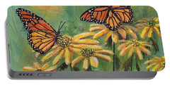 Portable Battery Charger featuring the painting Monarch Butterflies by Lou Ann Bagnall