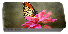 Monarch Butterfly And Pink Zinnia Portable Battery Charger by Judy Palkimas