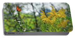 Portable Battery Charger featuring the photograph Monarch Butterfly Flyaway by Kerri Farley