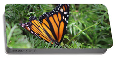 Monarch Butterfly In Lush Leaves Portable Battery Charger