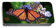 Portable Battery Charger featuring the photograph Monarch In The Mist by Kerri Farley