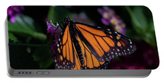 Portable Battery Charger featuring the photograph Monarch by Jay Stockhaus