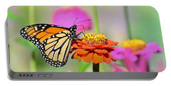 Portable Battery Charger featuring the photograph Monarch On A Zinnia by Rodney Campbell