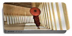 Monk With Umbrella Walking In Th Light Passway Portable Battery Charger