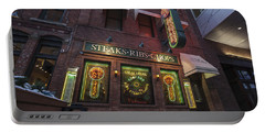 Portable Battery Charger featuring the photograph Monroe St Steakhouse by Nicholas Grunas