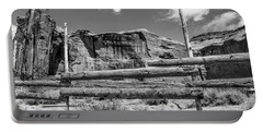 Portable Battery Charger featuring the photograph Fence In Monument Valley - Bw by Dany Lison