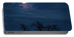Portable Battery Charger featuring the photograph Moonlight Through A Blue Evening Sky by Tim Bryan