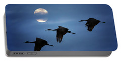 Portable Battery Charger featuring the photograph Moonlit Flight by Susan Rissi Tregoning