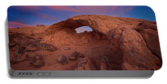 Portable Battery Charger featuring the photograph Moonrise Arch by Edgars Erglis