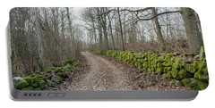 Portable Battery Charger featuring the photograph Mossy Stone Walls Along A Country Road by Kennerth and Birgitta Kullman
