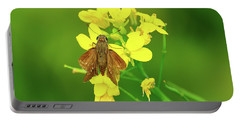 Moth On Mustard Flower Portable Battery Charger