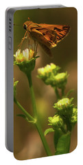 Moth Sitting On Yellow Flower Portable Battery Charger